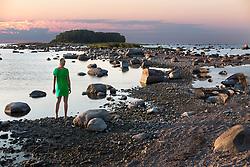 Woman standing on Käsmu beach, Estonia.