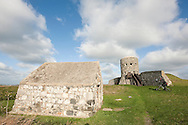 Loophole tower at Rousse, Vale, with powder magazine in foreground. This is one of 15 such towers built on the island in 1778-79. Guernsey, Channel Islands, UK (November 2015) © Rudolf Abraham