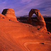 Elegant and graceful, world famous Delicate Arch frames the La Sal Mountains in Arches National Park, Utah.