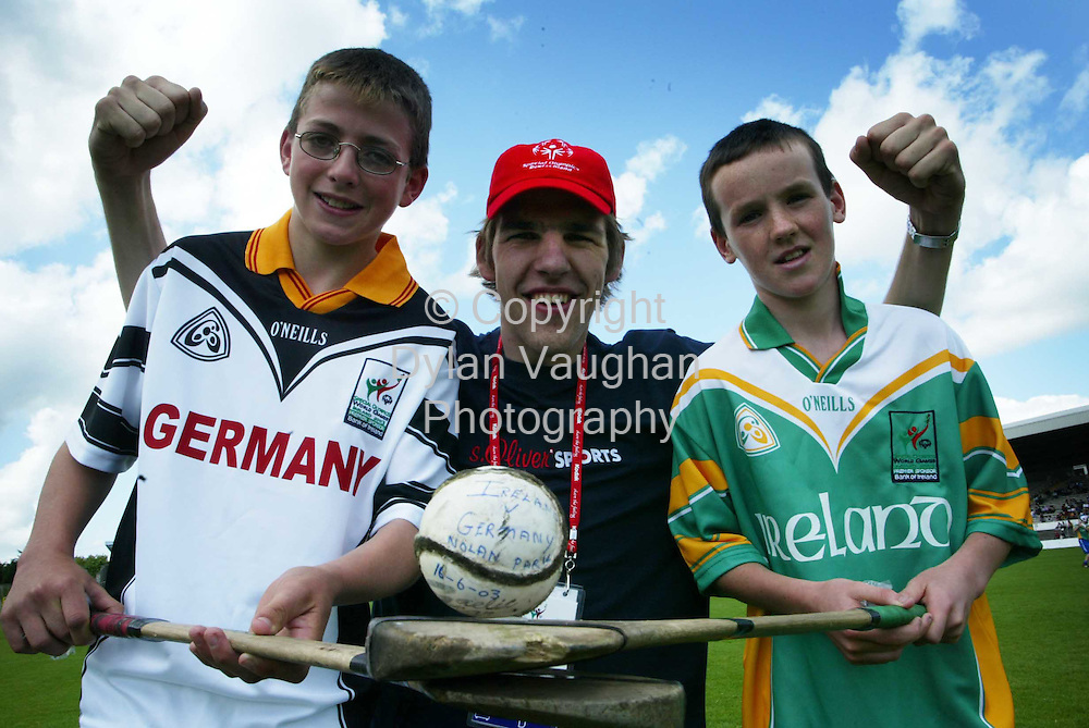 17/6/2003.Urs Gunthor of the German Special Olympics volley ball team pictured with Ian Duggan aged 11 from Newmarket National School in Kilkenny and Martin Gaffney aged 11 from CBS Kilkenny at an exhibition match of hurling at Nowlan Park yesterday by children from schools around the county..Picture Dylan Vaughan