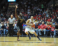 "Ole Miss' Marshall Henderson (22) drives against Missouri's Keion Bell (5) at the C.M. ""Tad"" Smith Coliseum on Saturday, January 12, 2013. Ole Miss defeated #10 ranked Missouri 64-49."