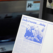 """DENVER - FEBRUARY 26:  A printing plate of one of the pages of the  final edition of the Rocky Mountain News sits beside the presses as copies get set to roll off the presses at the E.W. Estlow printing facility in Denver, Co. late Thursday evening. The newspaper had been put up for sale by its owner, E.W. Scripps, but the search for a buyer proved unsuccessful. """"Denver can't support two newspapers any longer,"""" Scripps CEO Rich Boehne told staffers, some of whom cried at the news. """"It's certainly not good news for you, and it's certainly not good news for Denver."""" The Rocky was founded in 1859 by William Byers, one of the most influential figures in Colorado history. Scripps bought the paper in 1926 and immediately began a newspaper war with The Post. That fight ebbed and flowed over the course of the rest of the 20th century, culminating in penny-a-day subscriptions in the late '90s. The closure will cost 228 newsroom employees their jobs..(Photo by Marc Piscotty/ © 2009)"""