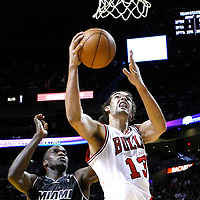 29 January 2012: Chicago Bulls center Joakim Noah (13) goes for the layup past Miami Heat center Joel Anthony (50) during the Miami Heat 97-93 victory over the Chicago Bulls at the AmericanAirlines Arena, Miami, Florida, USA.