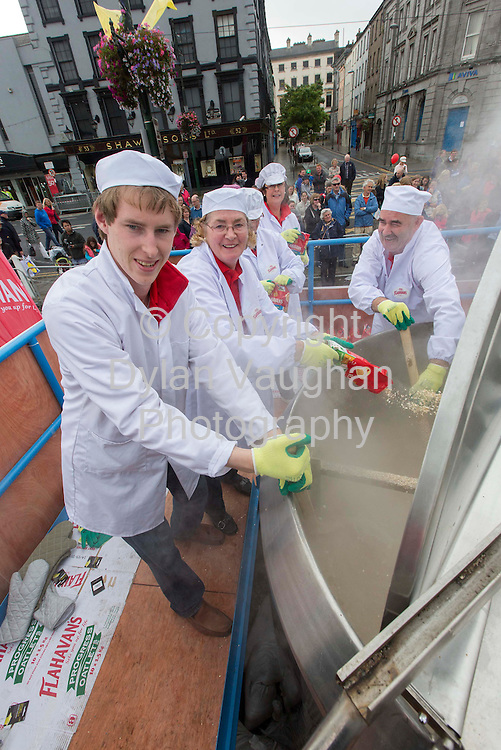Repro Free..16/9/2012.Organiser's of Ireland's biggest food festival 'Harvest' in conjunction with Flahavan's have cooked up the World's largest bowl of porridge weighing in at 1380Kg today at the Waterford Harvest Festival. (Sunday, September 16, 2012)...Pictured at the attempt was from left Philip Flahavan Mary Flahavan, Audrey Dowling and Tony Gannon...Picture Dylan Vaughan....The official attempt was carried out on the Quayside in Waterford city at the Harvest Festival and is to be verified by Guinness in the coming weeks...The huge breakfast of 1380Kg of porridge has exceeded the target of 914Kg, the year the city of Waterford was founded. During the process a specially-made bowl measuring 1.4 metres in height and 1.7 metres in diameter was used...The world record attempt for the largest bowl of porridge began at 7am and finished at 1pm, taking approximately 6 hours to cook. The world's largest bowl of porridge produced over 5,500 servings and was enjoyed by all attending the Festival...Flahavan's, producers of Ireland's most popular porridge are thrilled with the new world record. Commenting on the challenge John Flahavan said, ?We are thrilled that this record success has been brought to Waterford and Ireland for the first time. A great deal of planning and organizing has gone into the event prior to cooking up the 1380Kg of porridge. We are very grateful to all customers who came here today to support our record attempt. We also wish to thank all our staff, the Harvest Festival Committee and the Lions Club volunteers for all their help and support today.