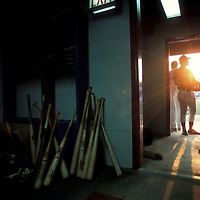 USA, Virginia, Prince William Yankees baseball player walks from locker room at minor league game in Carolina League