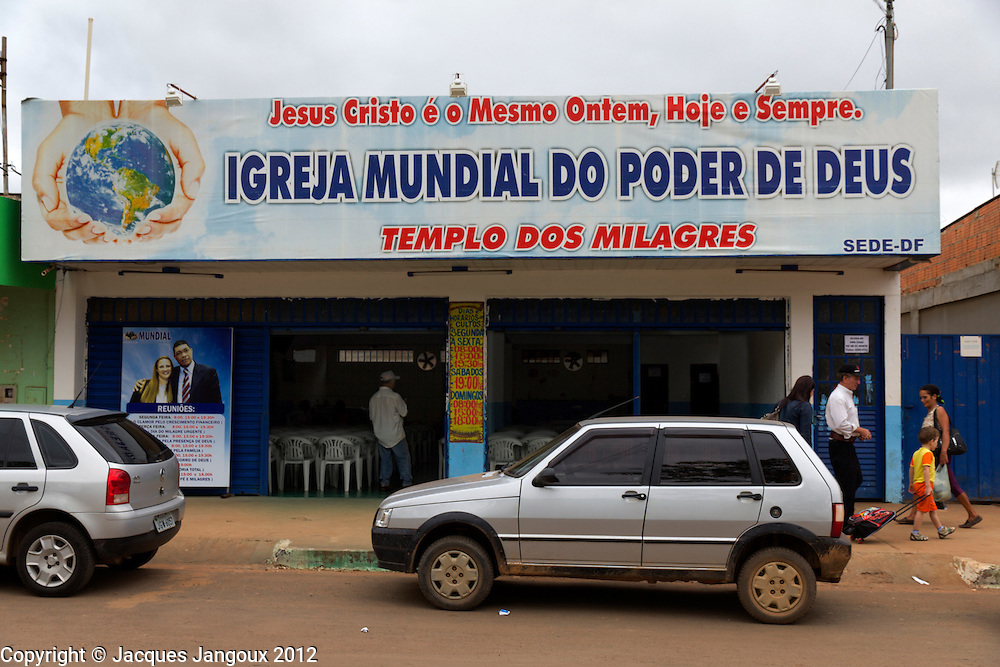 Protestant churches of many denominations, generically called evangelical, are spreading in Brazil, a predominantly Catholic country. Planaltina de Goiás, Goiás, Brazil. (Jesus Christ is the Same Yesterday, Today, and Always - Igreja Mundial do Poder de Deus: World Church of the Power of God - Temple of the Miracles)