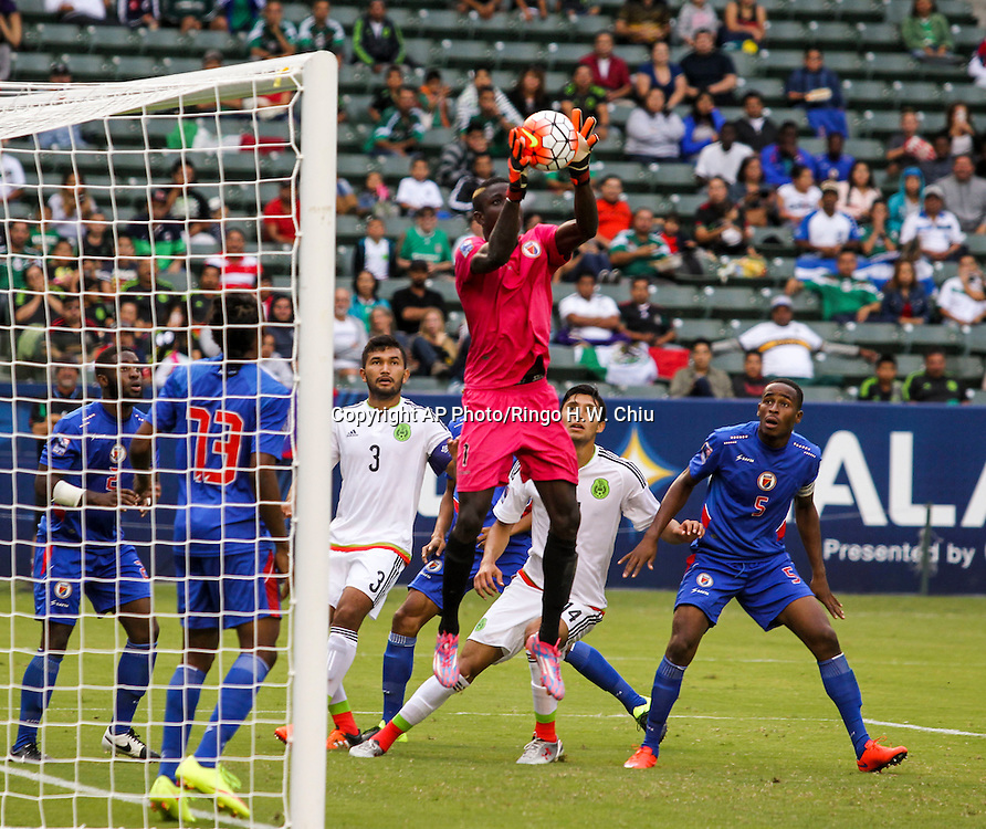 Haiti goalkeeper Luis Valendi Odelus makes a save against Mexico in the second half of a CONCACAF men's Olympic qualifying soccer match in Carson, Calif., Sunday, Oct. 4, 2015. Mexico won 1-0. (AP Photo/Ringo H.W. Chiu)