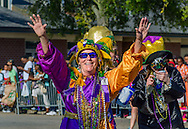 A reveler marches down Washington Street in downtown Mobile, Ala., during the Joe Cain Procession at Mardi Gras, March 2, 2014. French settlers held the first Mardi Gras in 1703, making Mobile's celebration the oldest Mardi Gras in the United States. (Photo by Carmen K. Sisson/Cloudybright)