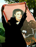 Wiedjai Sewgobind from Amsterdan holds up a banner outside the court where the Michael Jackson jury is deliberating in Santa Maria, California June 9. 2005. Jurors in Michael Jackson's sex-abuse trial returned to court for a fifth day of deliberations, hours after the pop star returned home from another trip to the hospital.