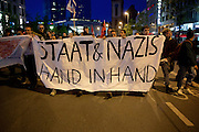 Frankfurt am Main   21 Apr 2015<br /> <br /> Am Dienstag (21.04.2015) hielt die rassistische und islamfeindliche Gruppe PEGIDA (Patriotische Europ&auml;er gegen die Islamisierung des Abendlandes) an der Hauotwache neben der Katharinenkirche in Frankfurt am Main eine Mahnwache unter dem Motto &quot;Wir sind wieder da&quot; ab. Die Kundgebung war wie immer mit Hamburger Gittern abgesperrt und von starken Polizeikr&auml;ften bewacht. Etwa 1000 Menschen nahmen an den Gegenprotesten teil.<br /> Hier: Gegendemonstranten mit einem Transparent mit der Aufschrift &quot;Staat und Nazis Hand in Hand&quot; bei einer Spontandemo nach Ende der Pegida-Kundgebung auf dem Weg zum Hauptbahnhof, bei dieser Demo ging es um Flucht und Fl&uuml;chtlinge.<br /> <br /> &copy;peter-juelich.com<br /> <br /> [Foto Honorarpflichtig   No Model Release   No Property Release]