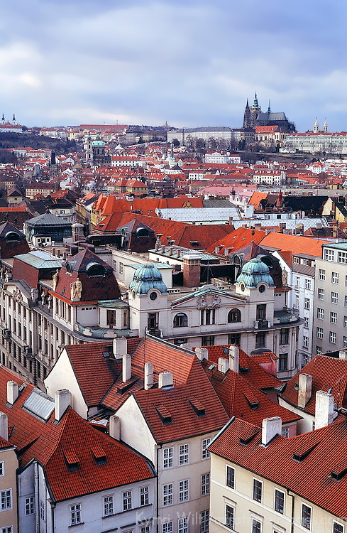 Europe, Czech Republic, Prague. Elevated view of Prague Old Town with cathedral in distance.