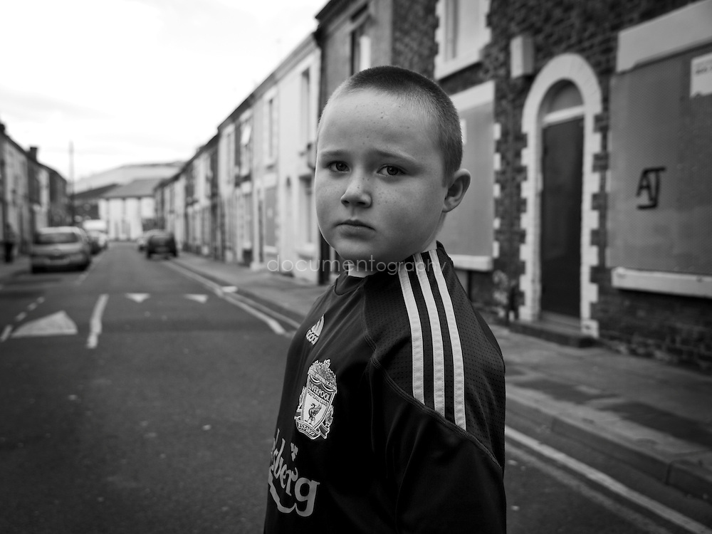 Connor Thompson in his deserted street with the Liverpool FC Stadium in the background...OLYMPUS DIGITAL CAMERA