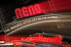 """Downtown Reno 2""  These Reno, The Biggest Little City in the World and Harrah's sign were photographed in Reno, Nevada. The effect was obtained in camera by long exposure mixed with intentional camera movement."