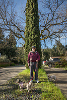 Calistoga resident Bill McMahon with his dogs, Li'l Abner and Daisy Mae.