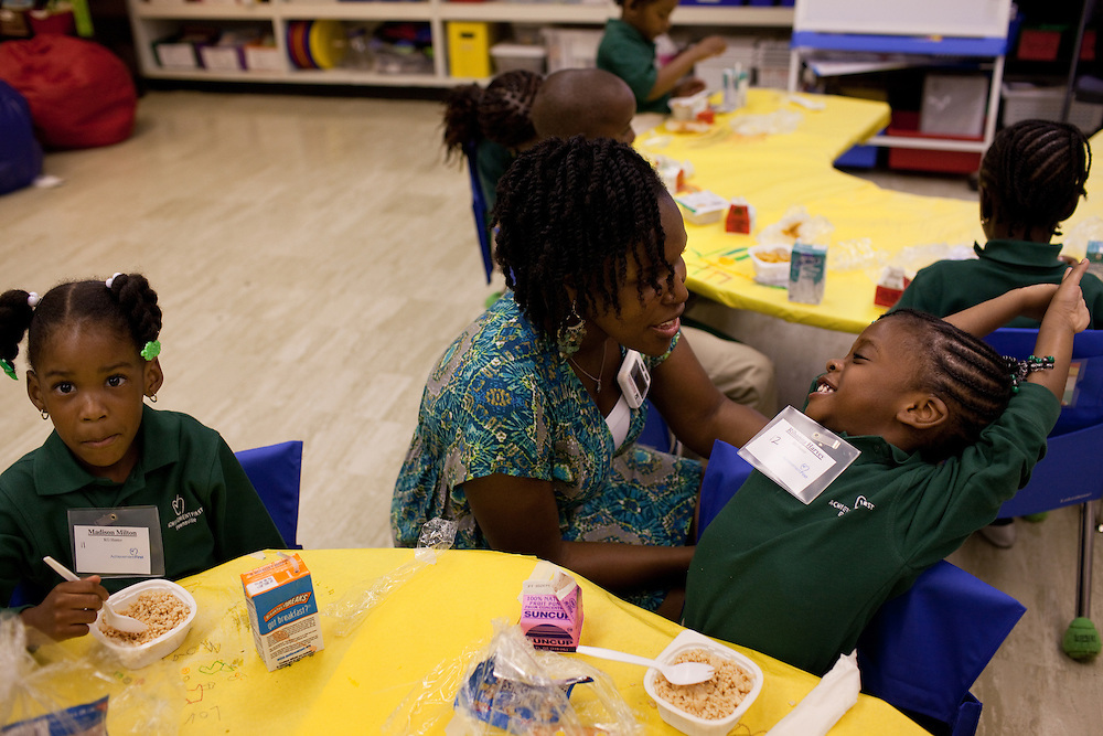 Madison Milton, left, and Rihanna Harvey, right, talk with kindergarten teacher Keisha Mercury (?) on the first day of class at Brownsville Elementary School in Brooklyn, NY on August 15, 2011.