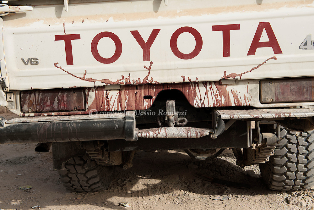 Libya: dry blood of a wounded fighter is seen on the rear of a military car of forces affiliated with Libya's Government of National Accord's (GNA). Alessio Romenzi