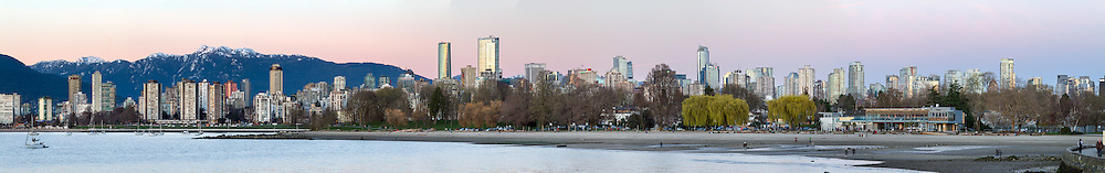 Kitsilano Beach and buildings in the West End and downtown Vancouver at sunset. The mountain in the background is Mount Seymour. Photographed from Kitsilano Beach Park in Vancouver, British Columbia, Canada. Full resolution file is 32238 x 5063 pixels.