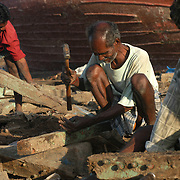Villagers in the Nagapattinam district of Tamil Nadu, India, salvage nails and wood from destroyed fishing boats on January 25, 2005, after the area was struck by the Indian Ocean Tsunami on December 26, 2004. Generated by an earthquake on the ocean floor, the tsunami devastated the fishing industry along the southeastern coast of India. .