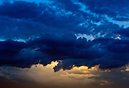 Color digital fine art photograph of blue clouds at dusk in the skies over North Las Vegas made by Chicago based photographer Kavet M. Kimble.