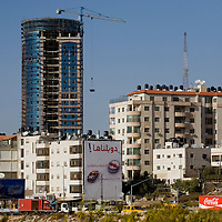 View of the Ersale neighborhoof and Palestiner tower the highest building under construction in the West bank...Photo by Olivier Fitoussi