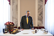 Sen. Charles Schumer waits to prepare Hudson Valley apple pie, sour cream ice cream, aged cheese and honey, which will be served for the inaugural lunch, on Friday, January 4, 2013 in Washington, DC.