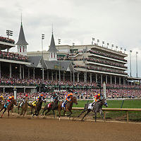 The field of the Kentucky Oaks heads into the first turn at Churchill Downs in Louisville, Ky, on May 3, 2013. Princess of Sylmar, obscured in the rear of this photo, won the Oaks. Photo by David Stephenson