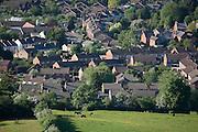 The suburban edge of Leckhampton meets rural fields,  Cheltenham Spa Town. Aerial view seen from Leckhampton Hill