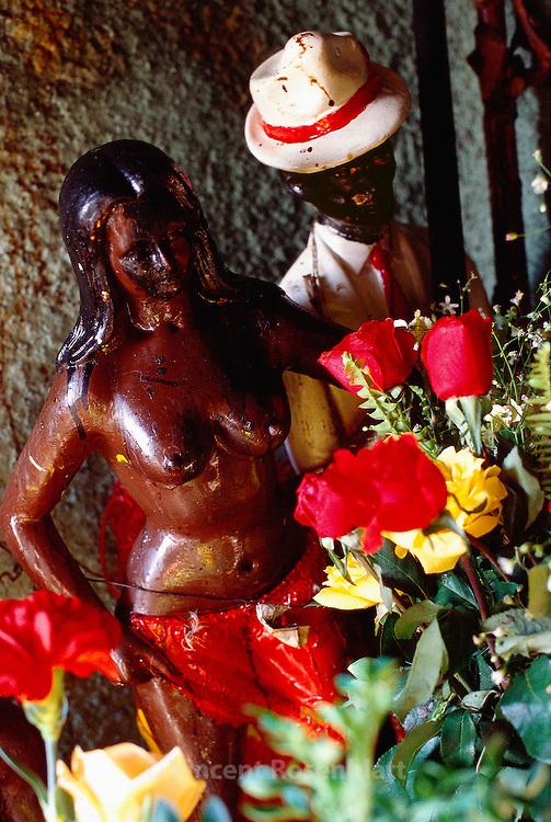 Afro-Brazilian religion Macumba in the favela Morro da Providencia in the old center of Rio de Janeiro : saints and offerings.. ||.Candomblé. Entrada da casa da Mae Baiana, Morro da Providencia.  Santos e  oferendas.