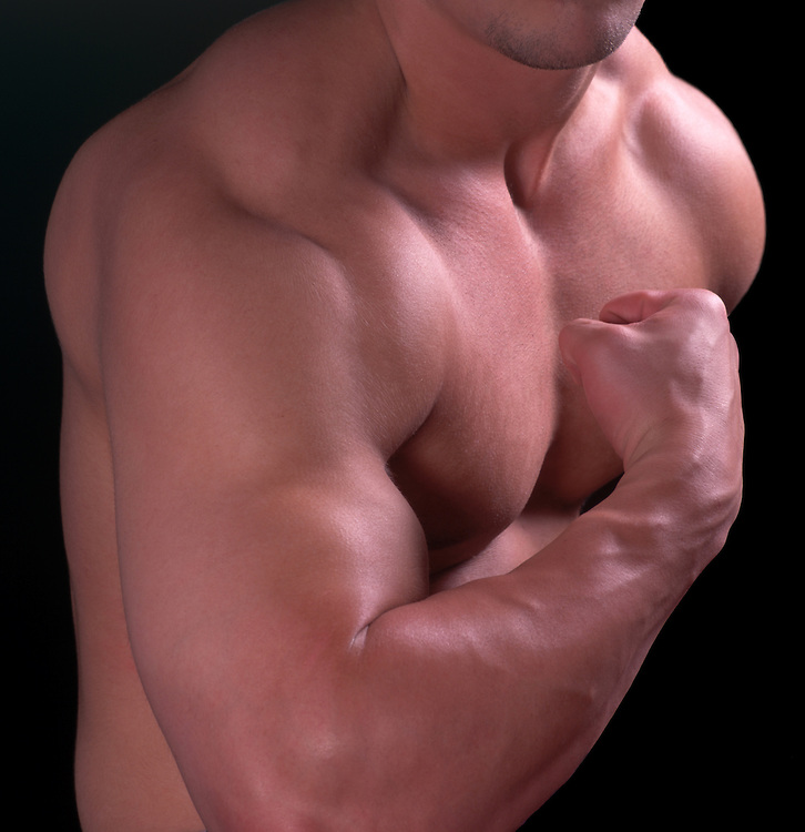 Athletic muscle-man flexes his pumped-up biceps and pectoral muscles for the camera. Veins pop in his arms and neck as he clenches his closed fist. Overdeveloped shoulder and back muscles bulge below his neck.