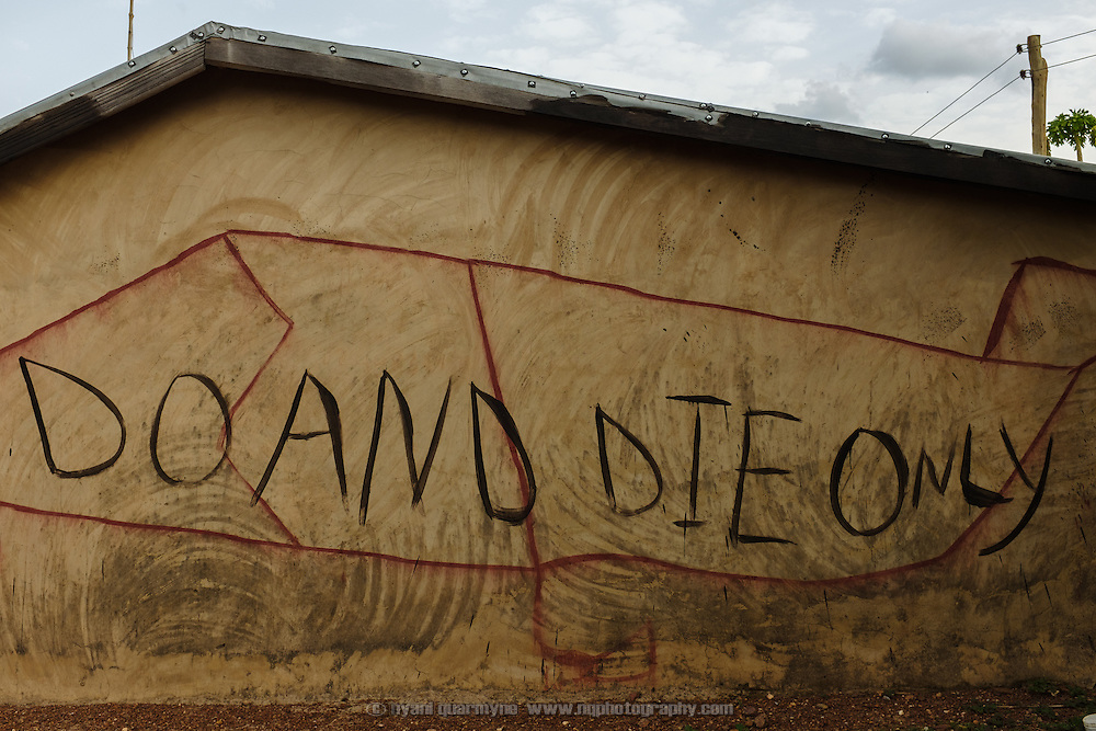 "The words ""Do and die only"", perhaps a corruption of ""do or die"", painted on the wall of a house in the village of Kangpuo in the Upper West region of Ghana on 25 June 2015."