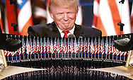 U.S. Republican Presidential Nominee Donald Trump is seen on a large television monitor as he speaks at the Republican National Convention in Cleveland, Ohio, U.S. July 21, 2016.  REUTERS/Rick Wilking   - RTSJ4DR