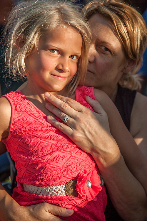 The Calistoga community attends the performance of the Santa Rosa band Kingsborough at Pioneer Park.  Jonnika Benjamin and her seven year old daughter, Abby.