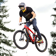 SHOT 7/28/11 2:47:14 PM - Brandon Semenuk gets airborne off a jump during slopestyle qualifiers at Crankworx Colorado at the Trestle Bike Park in Winter Park, Co. Semenuk finished second in the event with a score of 92.00. The event is a Pro-am mountain bike competition featuring a dual slalom race, the Trestle Unchained Challenge, slopestyle and cross country racing events where top pros competed for more than $35,000 in prize money. (Photo by Marc Piscotty / © 2011)
