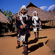 Akha women on their way to a festival at the Akha village Huei Naam Kun that is located in the mountains near Chiang Rai.