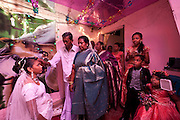 The bride to be awaits the time time to leave her home for a church wedding.<br /> She is blessed by her parents...