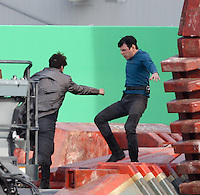 ***WORLD EXCLUSIVE*** February 21st 2012 <br /> Los Angeles, CA.  <br /> The first images from the set of the highly anticipated untitled Star Trek Sequel. The closely guarded plot of this film is partly revealed in these photos which show Zachary Quinto as Spock in a very intense fight with British Actor Benedict Cumberbatch who appears to be the film's Villain. Director JJ Abrams is seen on set meticulously choreographing &amp; directing this epic fight scene which took place on top of a Space Barge set. The set rotated 180 degrees during the fight scene with large green screens behind the actors. During the fight, it appears that Spock is unsuccessful against his adversary using his &quot;Vulcan Death Grip&quot;. Spock proceeds to get pummeled by the Villain who is wearing a black Star Fleet shirt. Photos by Eric Ford/On Location News 1/818-613-3955 info@onlocationnews.com