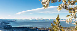 """""""Icicles Above Lake Tahoe 1"""" - Stitched panoramic photograph of icicles hanging from a tree above a snowy and blue Lake Tahoe."""
