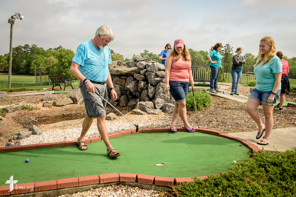fJoanna Johnson (right), new GEO missionary to Taiwan, plays mini golf with her sister Mary Johnson and her father, the Rev. Scott Johnson, pastor of St. John's Lutheran Church, Conover, N.C, during a fundraiser for a short-term parish mission trip to Alaska at the Hampton Heights Golf Club on Saturday, April 22, 2017, in Hickory, N.C. Johnson said she'll miss time spent with her family when she leaves for Taiwan as a missionary. LCMS Communications/Erik M. Lunsford