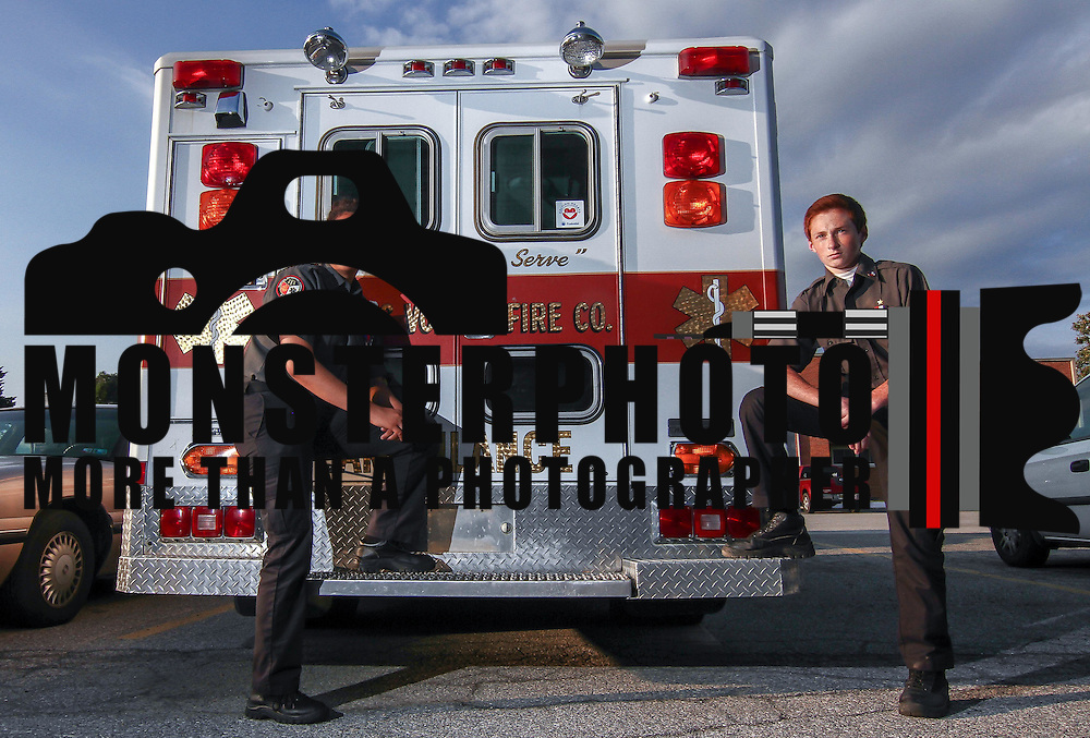 D.A.P.S.S. students Janelly Salazar (15), left, and Joshua Ritter (14), right, pose for a photo in front of a D.A.P.S.S emergency services vehicle Wednesday, June. 1, 2016 on the campus of Delaware Academy of Public Safety and Security in New Castle.