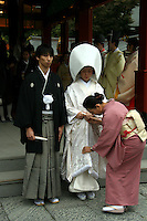 "Japanese Shinto Wedding - The Japanese couple must first be legally married by filing for marriage at their local government office, and the official documentation must be produced in order for the ceremony to be held. Traditionally, marriages were categorized into two types according to the method of finding a partner—miai, meaning arranged or resulting from an arranged introduction, and ren'ai, in which the principals met and decided to marry on their own.  The Japanese bride-to-be may be painted pure white from head to toe, visibly declaring her maiden status to the gods.  Traditional Japanese wedding customs ""shinzen shiki"" involve an elaborate ceremony held at a Shinto shrine."