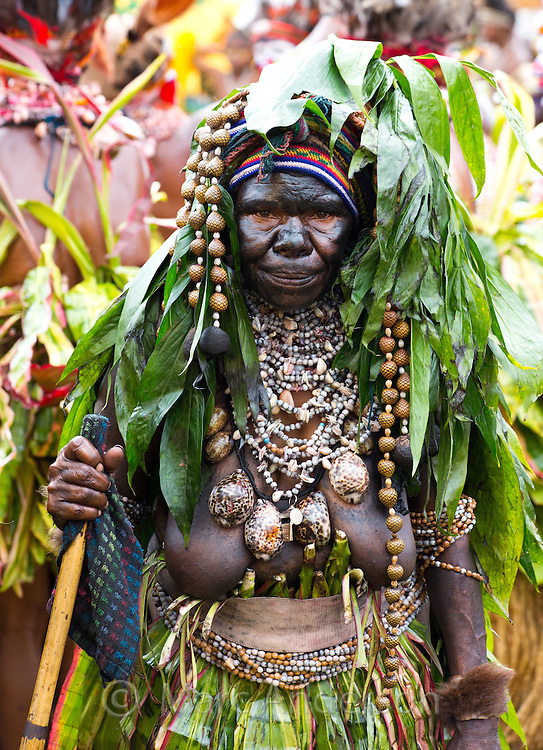 Portrait of an old woman dressed in traditional tribal dress for the Goroka Show, an annual Singsing Festival in the highlands of Papua New Guinea