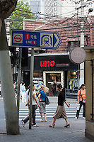 street scene in shaghai china with metro sign and locals