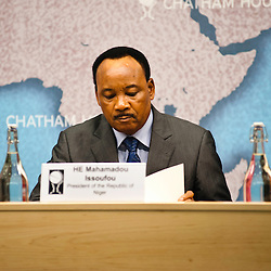 HE Mahamadou Issoufou, President of the Republic of Niger, reads notes during the ?Niger?s Growing Regional and International Importance? conference at Chatham House.