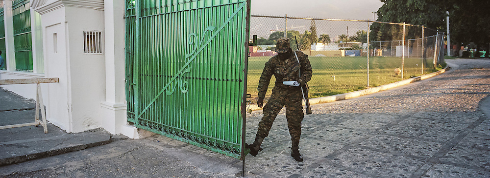 A guard at the former site of the Presidential Palace on Monday, December 22, 2014 in Port-au-Prince, Haiti. The palace was destroyed in the 2010 earthquake, and has since been demolished.