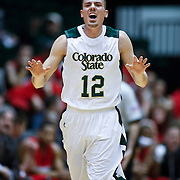SHOT 2/23/10 9:35:30 PM - Colorado State's Adam Nigon celebrates after scoring against New Mexico during the first half of their regular season Mountain West Conference game at Moby Arena in Fort Collins, Co. New Mexico survived a tight game winning 72-66. Nigon led Colorado State with 23 points in the game. (Photo by Marc Piscotty / © 2010)