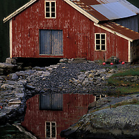 Small farms nestled along a small  fjord near Måloy on Norway's west coast.