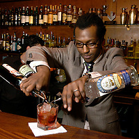 UK. London. A barista making cocktails in the Atlantic Bar in Central London..Photo©Steve Forrest/Workers' Photos.