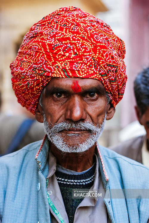 Portrait of a religious pilgrim from Rajasthan in Vishram Ghat in Mathura. Mathura is a sacred town situated on the banks of Yahuman river in Uttar Pradesh, northern India. The birthplace of the deity Lord Krishna. It is a pilgrimage site for Hindus.