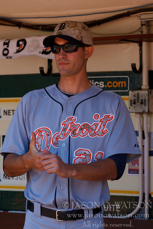 OAKLAND, CA - MAY 26:  Rick Porcello #21 of the Detroit Tigers stands in the dugout before the game against the Oakland Athletics at O.co Coliseum on May 26, 2014 in Oakland, California. The Oakland Athletics defeated the Detroit Tigers 10-0.  (Photo by Jason O. Watson/Getty Images) *** Local Caption *** Rick Porcello