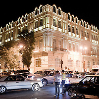 Baku, Azerbaijan, 24 July 2012<br /> Street view at night.<br /> Baku is the capital and largest city of Azerbaijan, as well as the largest city on the Caspian Sea and of the Caucasus region. <br /> It is located on the southern shore of the Absheron Peninsula, which projects into the Caspian Sea. The city consists of two principal parts: the downtown and the old Inner City (21.5 ha). <br /> Baku's urban population at the beginning of 2009 was estimated at just over two million people. Officially, about 25 percent of all inhabitants of the country live in the metropolitan city area of Baku.<br /> Photo: Ezequiel Scagnetti